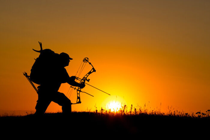 Bowhunter in Sunset